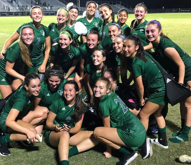 The Venice High girls soccer team poses for a picture after defeating Fleming Island 1-0 in a Class 6A state semifinal match Friday night at   Powell-Davis Stadium in Venice.