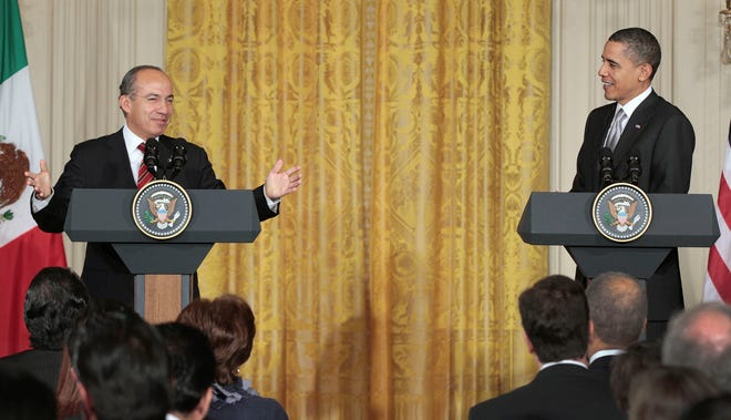 President Barack Obama listens as Mexican President Felipe Calderon talks during their joint news conference on March 3, 2011, in the East Room of the White House. Obama and Calderon agreed to deepen their cooperation in combating drug violence and declared a breakthrough in efforts to end a long-standing dispute over cross-border trucking.