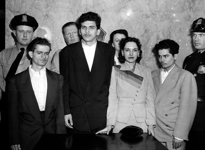 """Puerto Rican nationalists Irvin Flores Rodriguez, Rafael Cancel Miranda, Lolita Lebron and Andres Figueroa Cordero, all from New York, are standing in a police lineup following their arrest after a shooting attack on Capitol Hill, March 1, 1954. While shouting """"Free Puerto Rico,"""" the group, under the leadership of Lebron, opened fire from the visitor's gallery onto the floor of the U.S. House of Representatives, wounding five congressmen. The police standing in the back row are, from left: Gordon Rogers, Alf Sandberg, Frances McCall and P.J. Jordan."""