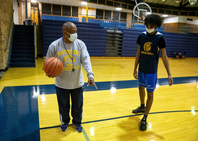 Southeast boys basketball head coach Lawrence Thomas works with senior James Dent, right, during practice in Herb Scheffler Gymnasium at Southeast High School in Springfield on January 28. Dent had 23 points as the Spartans beat Sacred Heart-Griffin on Friday, Feb. 26. [Justin L. Fowler/The State Journal-Register]