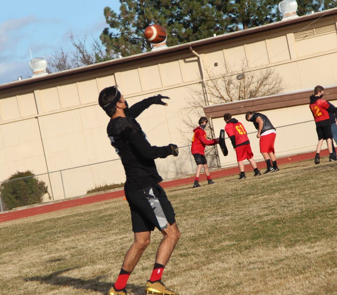 The Yreka High School football team takes part in their first practice in months Friday.