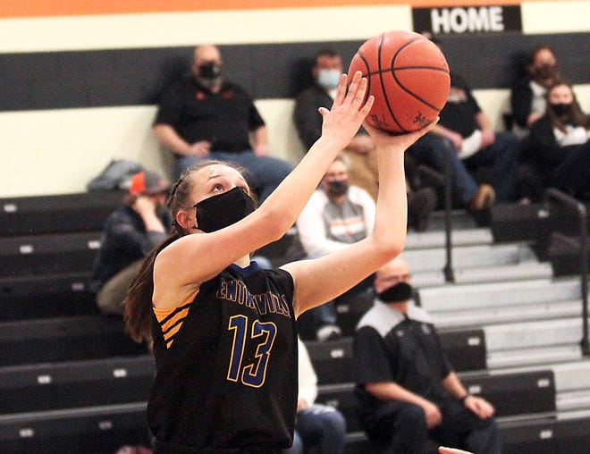 Bella Kangas scores two points against Marcellus  on Friday night.