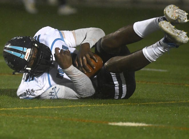 Hoggard's Xavier James-Smith recovers a blocked punt in the end zone to make it 6-0 against New Hanover on Friday night at Legion Stadium. It was one of three blocked punts in the season opener.