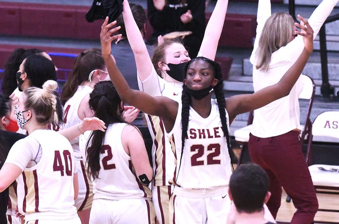 Ashley's Saniya Rivers celebrates with her team after beating Millbrook in the third round of the 4A playoffs on Saturday. The Screaming Eagles play in the state semifinals Tuesday.