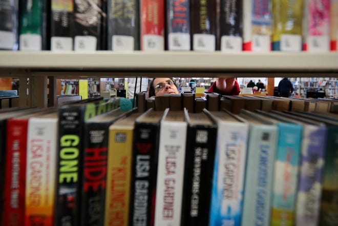 In this 2014 file photo, Lu-Ann Viera browses for a good read at the Southworth Library in Dartmouth.