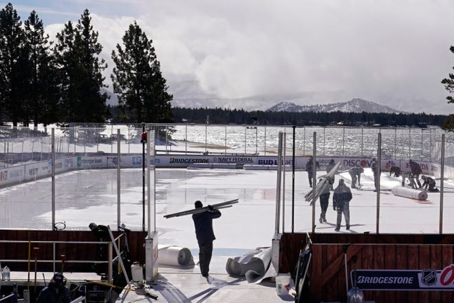 Workers put the finishing touches on the temporary ice rink, built at the Edgewood Tahoe Resort, that hosted two NHL games last weekend at Lake Tahoe.