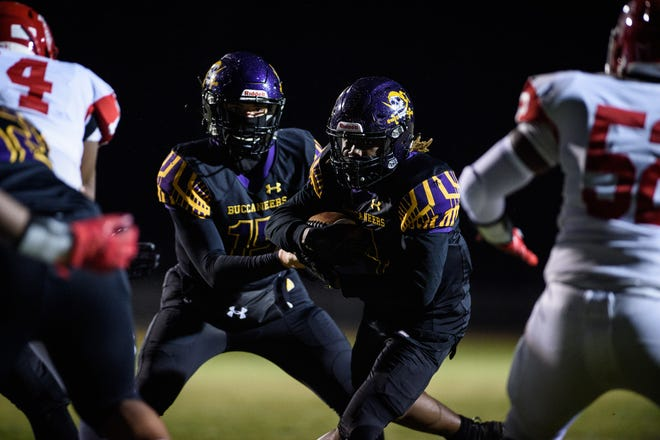 Jack Britt's Sincere Baines (4) had a game-high 102 rushing yards in the Bucs' 14-0 win against Seventy-First on Friday night.