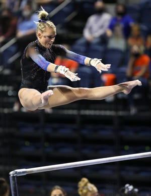 Florida gymnasts Alyssa Baumann performs on the bars against Auburn at Exactech Arena in last month.