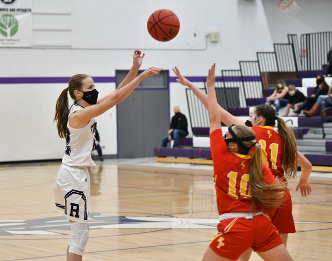 Rye junior Sydney Adamson fires a jumper over two Rocky Ford defenders in the Thunderbolts' 52-48 win over the Meloneers Friday, Feb. 26