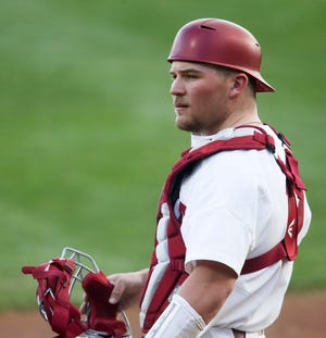 Alabama catcher Sam Praytor (19) looks to the dugout for the pitch sign as the Crimson Tide hosted Wright State Friday, Feb. 26, 2021 to open a weekend series in Sewell-Thomas Stadium. [Staff Photo/Gary Cosby Jr.]