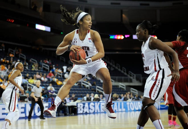 South Carolina forward Ashley Bruner, center, rebounds against Alabama as  forward Elem Ibiam boxes out during the second half of an NCAA college basketball game in the Southeastern Conference tournament, Thursday, March 7, 2013, in Duluth, Ga. (AP Photo/John Amis)