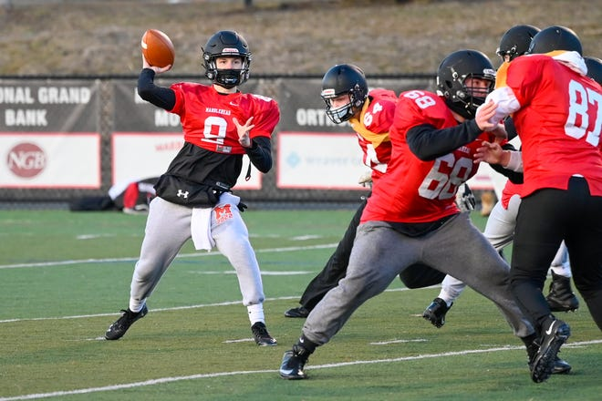 Marblehead quarterback Josh Robertson is shown getting set to pass the ball during a practice at Marblehead High School last February. Robertson is back this fall as one of four senior captains looking to continue their undefeated ways.