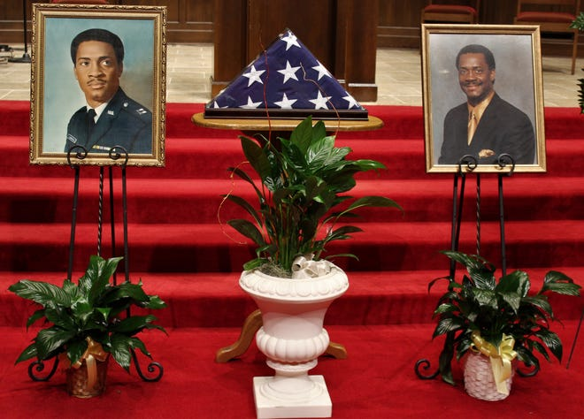 Portraits of Eddie Jordan on display at First Baptist Church, where a memorial service for the late Abilene Pastor was held Saturday.