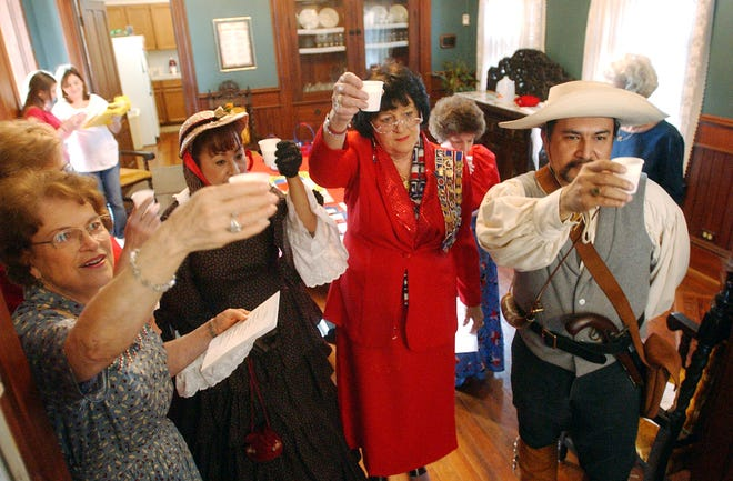 """Chobie Stringham (from left), Sylvia Budd, LaNell Wright and Thomas Guzman lifted their glasses in a """"Toast to Texas"""" to celebrate Texas Independence Day at the Irish Cultural House on 1501 N. Chaparral St. on March 2, 2004. Celebrants dressed in 1830's-style clothing, and the Daughters and Sons of the Republic of Texas-Clara Driscoll Chapter discussed the holiday."""