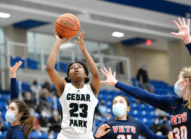 Cedar Park's Alisa Knight goes up for a basket against Corpus Christi Veterans Memorial in the teams' Class 5A regional semifinal game Saturday in San Antonio. Cedar Park won 61-39 and will play Georgetown in the regional finals.