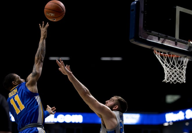 Xavier Musketeers guard Dwon Odom (11) shoots over Creighton Bluejays guard Mitch Ballock (24) in the first half of the men's NCAA basketball game on Saturday, Feb. 27, 2021, at the Cintas Center in Cincinnati.