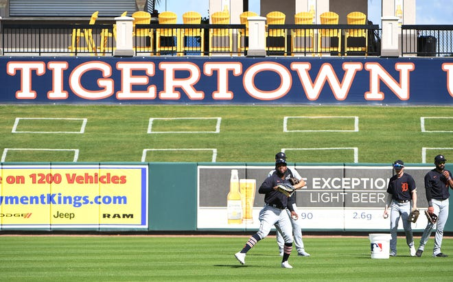 Tigers outfielder Akil Baddoo throws the ball during workout at Joker Marchant Stadium in Lakeland, Florida, on on Feb. 27, 2021.