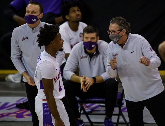 University of Evansville's Shamar Givance (5) talks to University of Evansville Head Coach Todd Lickliter during the first half against the Missouri State University Bears at Ford Center in Evansville, Ind., Friday, Feb. 26, 2021. The Purple Aces fell 90-81 to the Bears, who they will face again at 6 p.m. Saturday, Feb. 27.
