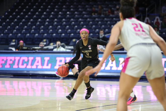Florida State guard Bianca Jackson (0) dribbles during Florida State's 72-64 loss at the Edmund P. Joyce Center in South Bend, IN., on Feb. 25, 2021.