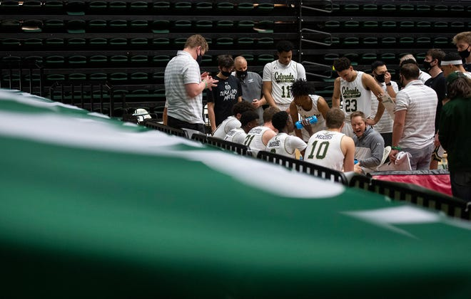 Colorado State head coach Niko Medved speaks with his team during a timeout in the second half of the game at Moby Arena at Colorado State University in Fort Collins, Colo. on Saturday, Feb. 27, 2020.