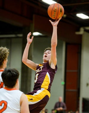 Belt's Aidan McDaniel attempts an off balance shot in Friday's game against Chinook during the boys' Northern C Divisional Basketball Tournament at the Four Seasons Arena in Great Falls.