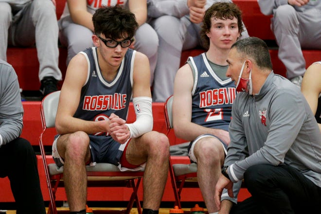 Rossville head coach Cory Dunn talks with Rossville's Damon Shaw (2) during the third quarter of an IHSAA boys basketball game, Friday, Feb. 26, 2021 in West Lafayette.