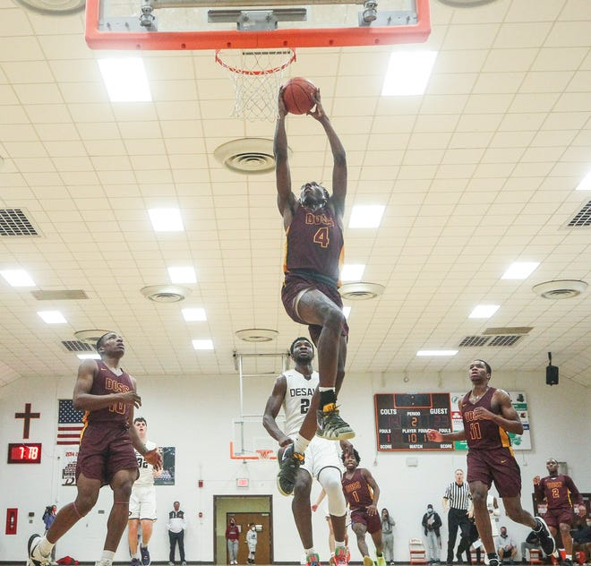 Doss' Tony Moss goes for two during the DeSales-Doss game Friday night at DeSales High School.