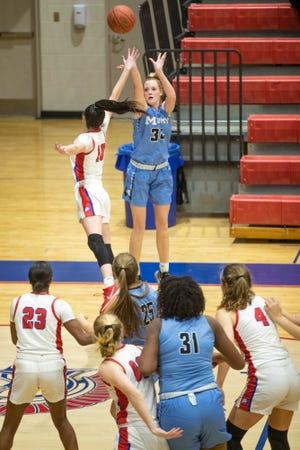 Mercy's Emma Barnett puts up a three-pointer as the Christian Academy Centurions took on visiting Mercy High School Jaguars Friday evening. Feb. 26, 2021