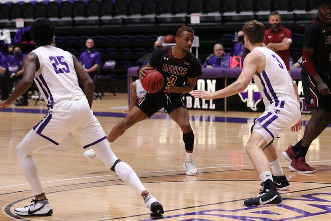 New Mexico State junior C.J. Roberts creates some space with a stepback during New Mexico State's game against Tarleton State on Feb. 26, 2021, in Stephenville, Texas.