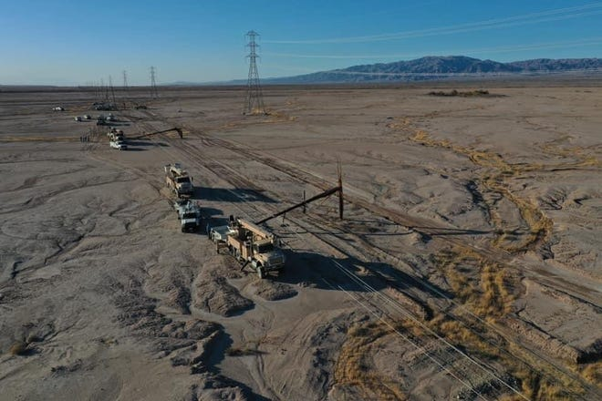 IID energy crews continued Friday, Feb. 26, 2021, to work to restore electrical service to customers in the southeastern Coachella Valley after high winds took down 14 power poles along a major transmission line.