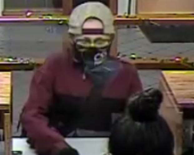 This is a surveillance photo of a serial bank robber dubbed the 'Piggy Bank Bandit' who is suspected of robbing two banks in Phoenix on Friday, Feb. 26, 2021, in addition to four other banks and credit unions since December 2020.