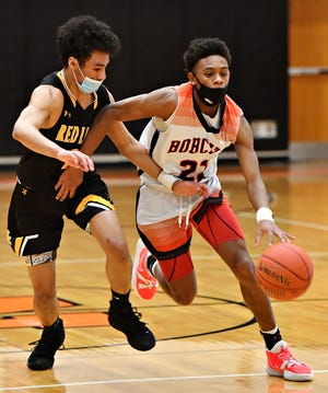 Northteastern's Karron Mallory, right, moves the ball down the court while Red Lion's AJ Virata defends during boys' basketball action at Northeastern Senior High School in Manchester, Friday, Feb. 26, 2021. Northeastern would win the game 42-41. Dawn J. Sagert photo