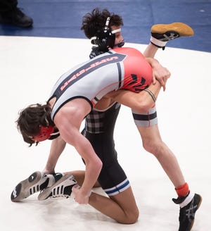 Chambersburg's Karl Shindledecker, back, wrestles Dover's Mason Leiphart in the 120-pound championship bout during the PIAA Class 3A District 3 SC Region wrestling championships at Spring Grove Area High School on Saturday, February 27, 2021. Shindledecker won by decision, 4-2.