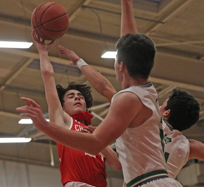 Christoval's Landon Scott, center, drives to the basket during a playoff game against Eldorado in San Angelo on Friday, Feb. 26, 2021.