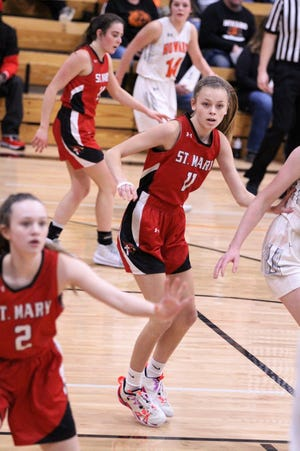 Addyson Gilbert defends against Howard in the Region 4B opening round game in Howard on Feb. 23, 2021.