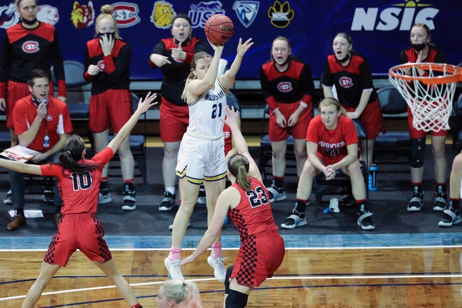 Augustana forward Hanna Mitby ( 21) shoots a jump shot against two St. Cloud St. defenders on Saturday February 27th at the Sanford Pentagon.  St. Cloud won 72-68.