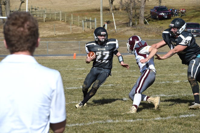 Buffalo Gap's Bryce Hildebrand (22) looks to avoid the Luray tackler while he gets a block from Jacob Craig (55) Saturday, Feb. 27. Buffalo Gap won 17-14 in overtime.