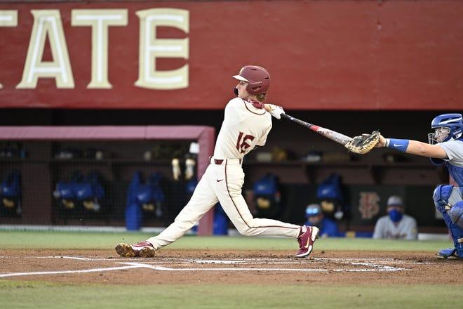 FSU first baseman Tyler Martin swings during the Seminoles' ACC opener against Pitt Feb. 26, 2021.