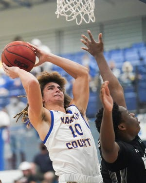 Martin County's Augie Lovelace (10) goes for a 2-point basket against Mater Academy Charter in a boys basketball 4-6A regional championship at Martin County High School on Friday, Feb. 26, 2021, in Stuart. The season ended for Martin County losing 60-62.