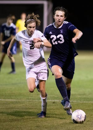 St. Johns Country Day junior Matthew Stratton (2) chases after possession in the Class 2A boys soccer semifinal against Vero Beach St. Edward's. The Spartans are pursuing their first-ever FHSAA boys title.
