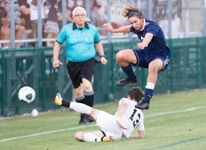 Luke Graston (bottom) of St. John's Country Day tries to take control of the ball from Drew Sternberg of St. Edward's School in the first half of the 2A state semifinal game on Friday, February 26, 2021, at St. Edward's School in Vero Beach. St. John's Country Day won 4-0.