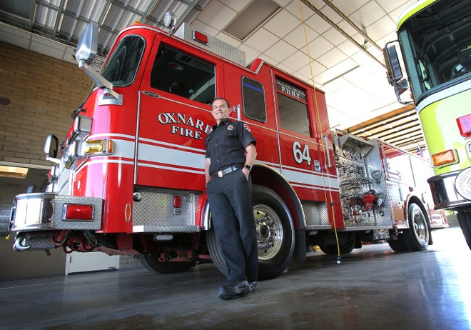 Alex Hamilton stands next to Oxnard Fire Station No. 4's fire truck. He is a 16-year veteran with Oxnard Fire Department and was sworn in as fire chief on Tuesday, March 2, 2021.