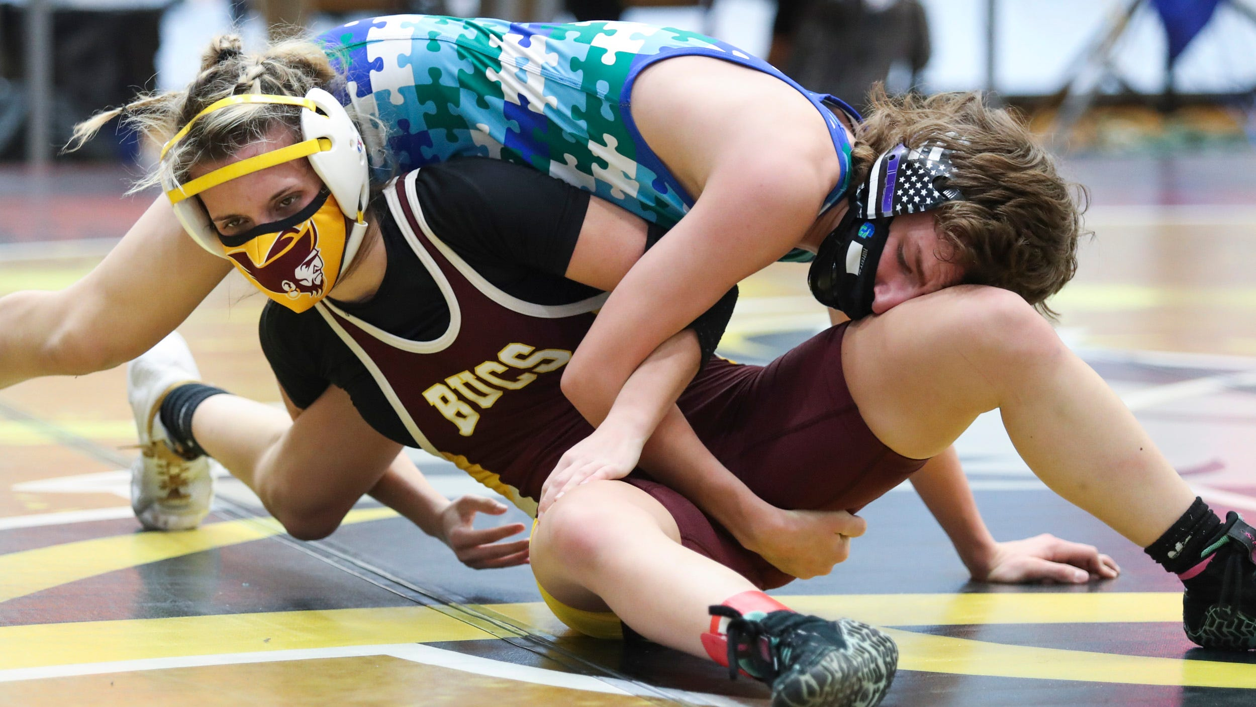 Caravel flexes early muscle in DIAA wrestling