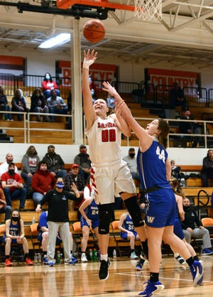 Faith Stinson goes up for a shot on Millie Ryan during Sheridan's 66-55 win against Vincent Warren in a Division II district final on Feb. 26 at Nelsonville-York. Stinson shared the Division II player of the year in the Southeast District with Circleville senior Kenzie McConnell.