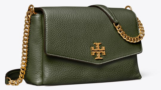 This pebbled leather purse features gold accents and an elevated look.