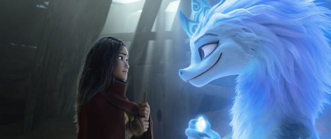 "Raya (voiced by Kelly Marie Tran, left) teams up with legendary water dragon Sisu (Awkwafina) in Disney's ""Raya and the Last Dragon."""