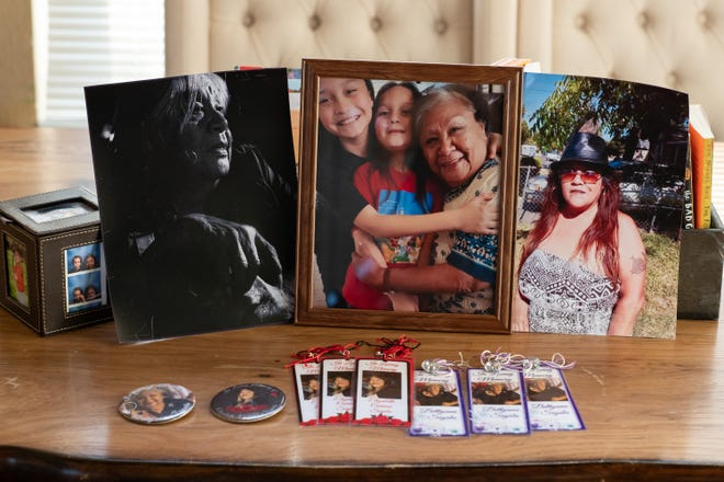 Photos of Elizabeth Sigala and Betty Ann Sigala who passed away from Covid-19 last year, in Leticia Aguilar's home in Elk Grove, Calif. on Friday, Feb. 26, 2021.
