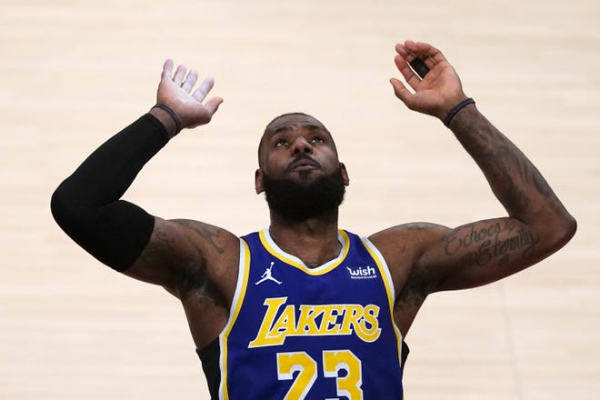 Los Angeles Lakers forward LeBron James gestures  in the first half against the Portland Trail Blazers at Staples Center.