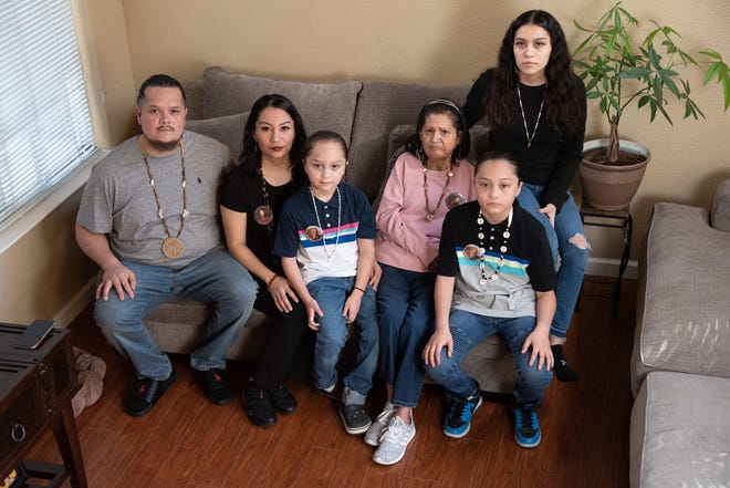 From left, Sergio Hinojosa Jr., Leticia Aguilar, Jordan Hinojosa, Jenny Sigala, Sergio Hinojosa III, and Angelina Hinojosa pose for a portrait in their home in Elk Grove, Calif. on Friday, Feb. 26, 2021.
