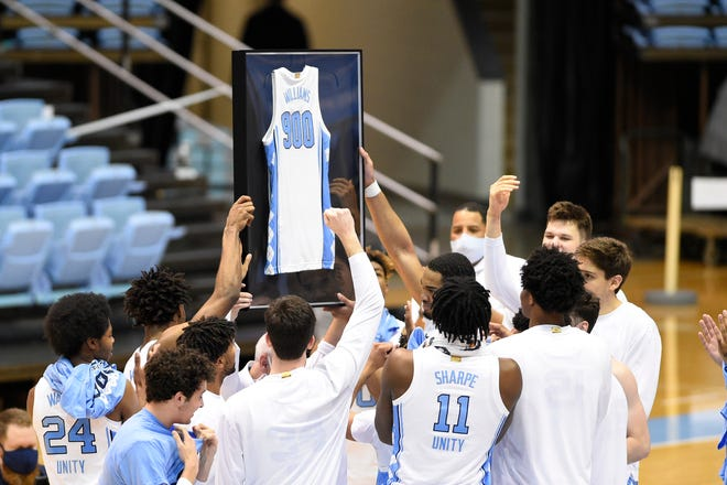 North Carolina head coach Roy Williams is honored after securing his 900th career win.